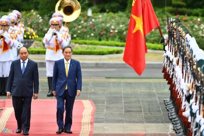 Japan's Prime Minister Yoshihide Suga arrives in Vietnam for official visit